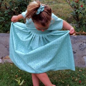 When my daughter was two and a half years old, I sewed her this dress. And a matching hair scrunching with left over material. I picked up my cam...