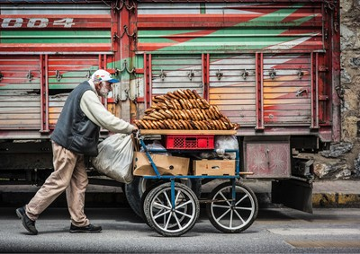 Captured while riding a taxi in Istanbul. We were going to the same market as this guy..
