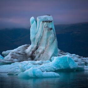 Taken during a trip to Iceland. The color on the glaciers and icebergs changed throughout the day with the change in lighting. I took this in the...