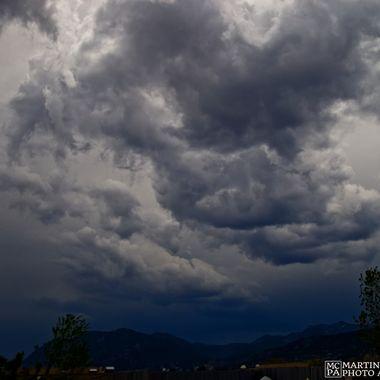 Storm clouds brewing over Cheyenne Mountain, Colorado Springs, Colorado