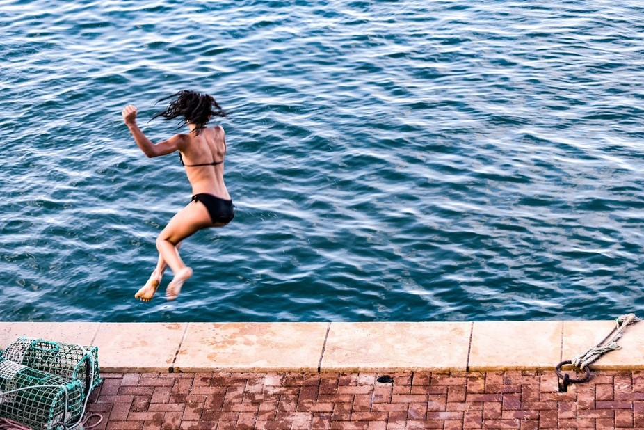 Taken in Cascais, Portugal. A group of young people were leaping into the sea. This is my favourite.