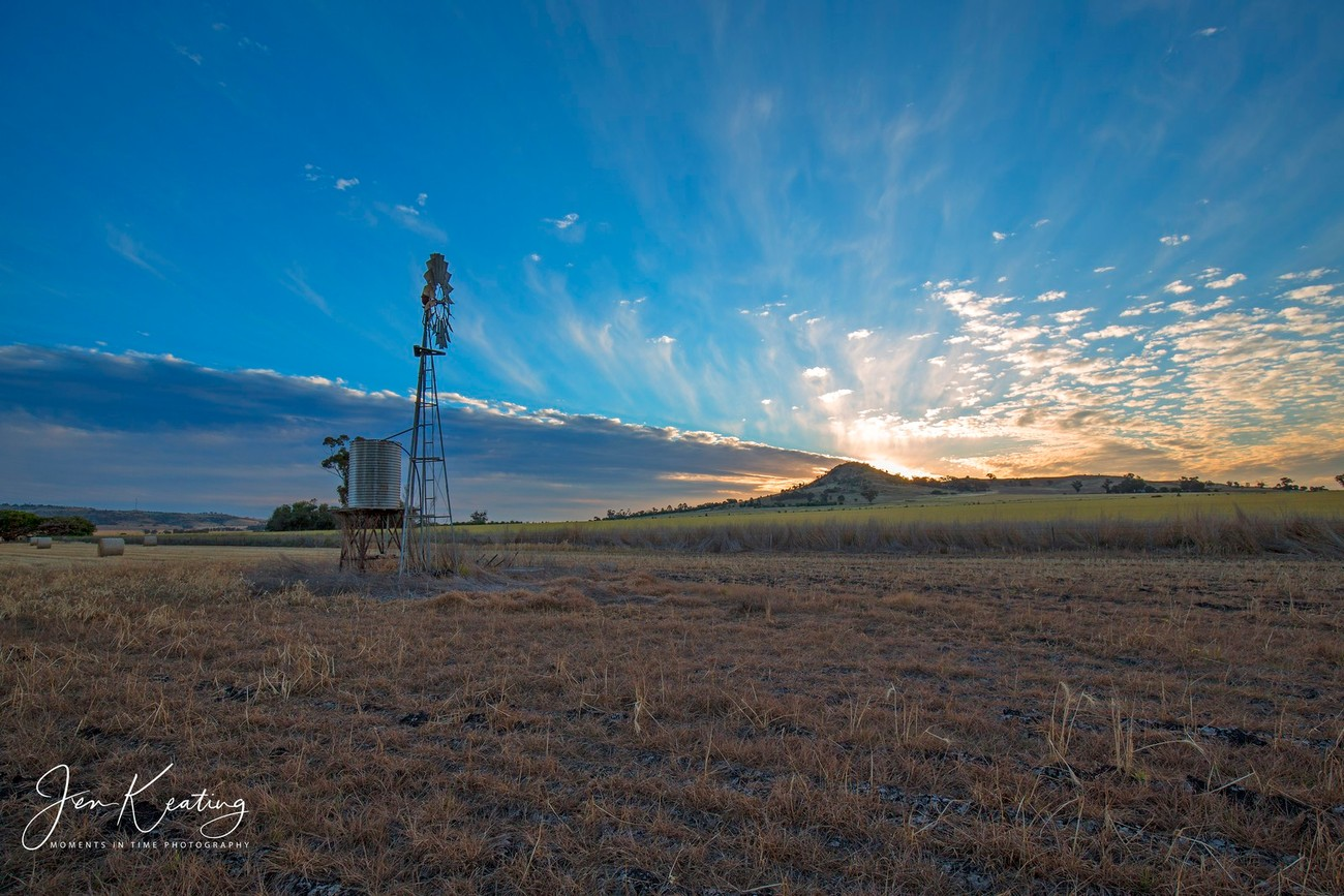 The windmill standing tall as the sun goes down behind Mt Saddleback in Dookie Australia