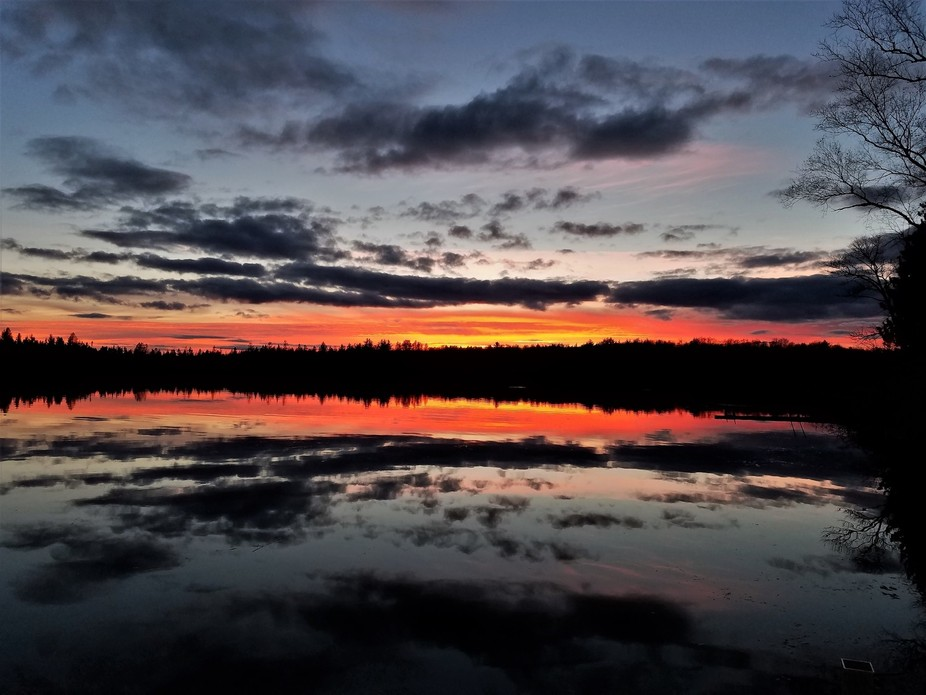 This is one of the sunsets I watched over the lake on my fishing trip in northern Wis.