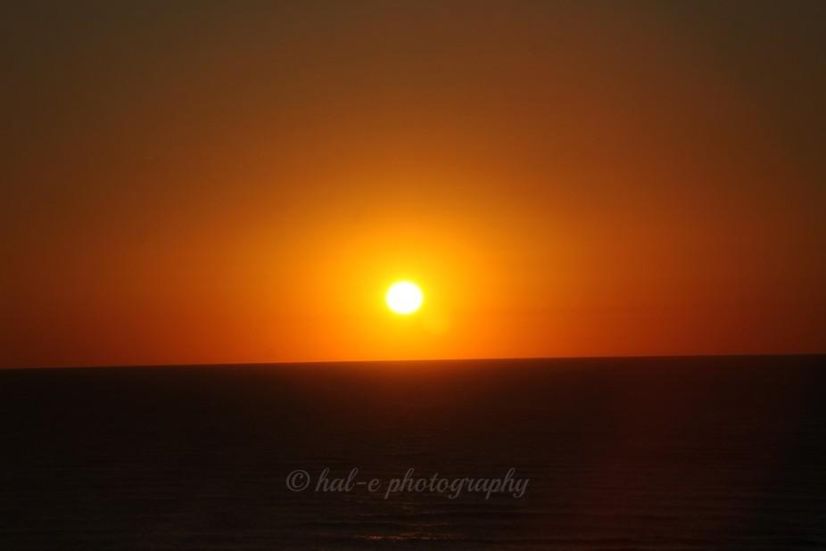 Sun rise over a calm ocean morning