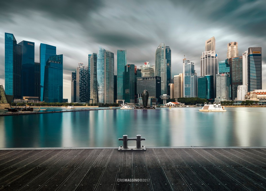 Brewing storm amidst the morning calm at the Marina Bay.