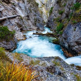 Beginning of a powerful river in a shady canyon in the Alps foothills. We had a great pleasure of evening hiking in this fantastic rocky place. I...