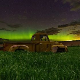 An old International pick-up rests in the prairies of northern South Dakota