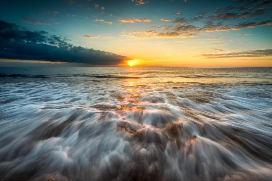Sunrise by the coast of the mediterranean sea. Costa Blanca, Spain