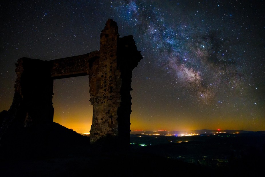 The core of the Milky Way, next to the ruin La Potence in the village of Allëgre in France.