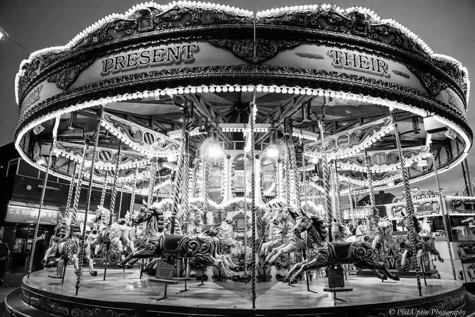 Black & White night shot of a Funfair carousel waiting to start.