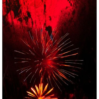 Red fireworks on bonfire night.