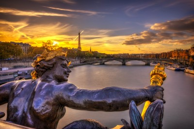 Sunset on the Eiffel tower from the Alexandre III bridge in Paris