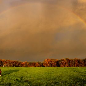 At sunset, just before the rainstorm broke loose, the rainbow appeared over the farmland
