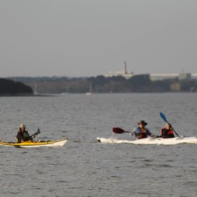 Kayakers enjoying an evening paddle. I like that the person in the yellow kayak is in focus, but the other two are not.