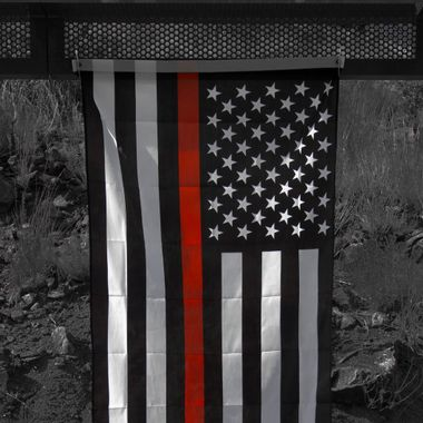 Yes, the flag is black and white with one red stripe.