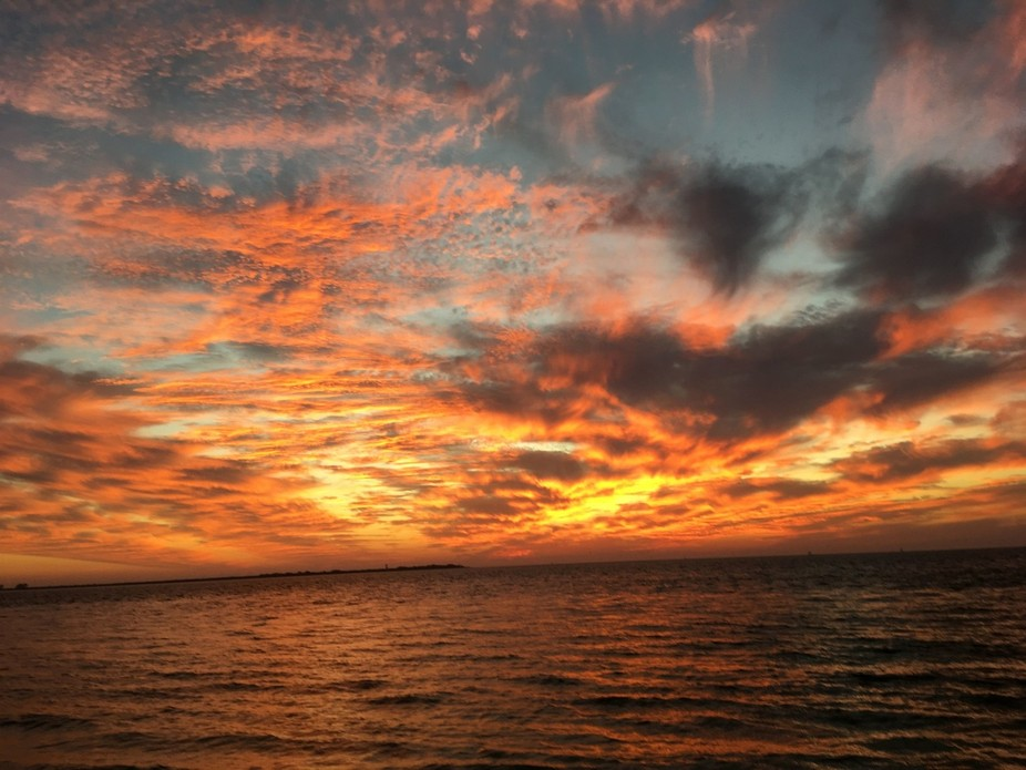 This photo was taken at the Fort Desoto Gulf Pier in Saint Petersburg Florida. The sunset was ama...
