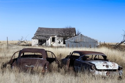 Old house with cars