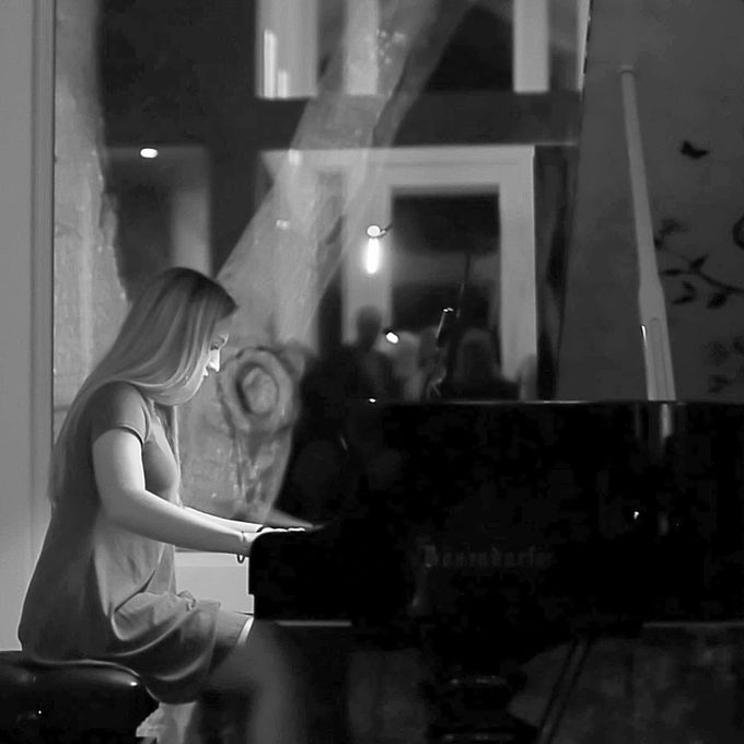 An intimate performance with the monterey symphony and piano prodigy Audrey Yellich, this image was captured accenting the ambiance as she played for the small audience to raise funds for music for schools