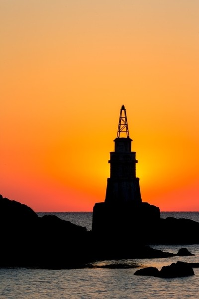 The Sun is hiding behind the Ahtopol lighthouse in Bulgaria