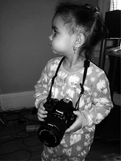 Daughter holding  dslr