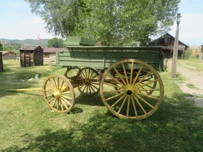 Green and yellow antique John Deere wagon