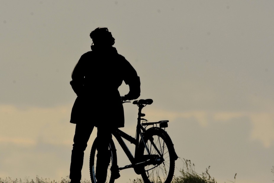 Lady and her Bicycle in Silhouette