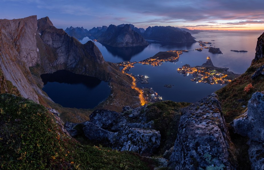 Epic views from the top Reinebringen in Lofoten at dawn.