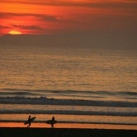 End of day for two surfers as the sun sets in Huntington Beach,  California. All rights reserved ©Pix.by.PegiSue