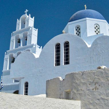 The dome and bells of a Greek Orthodox church on the island of Santorini