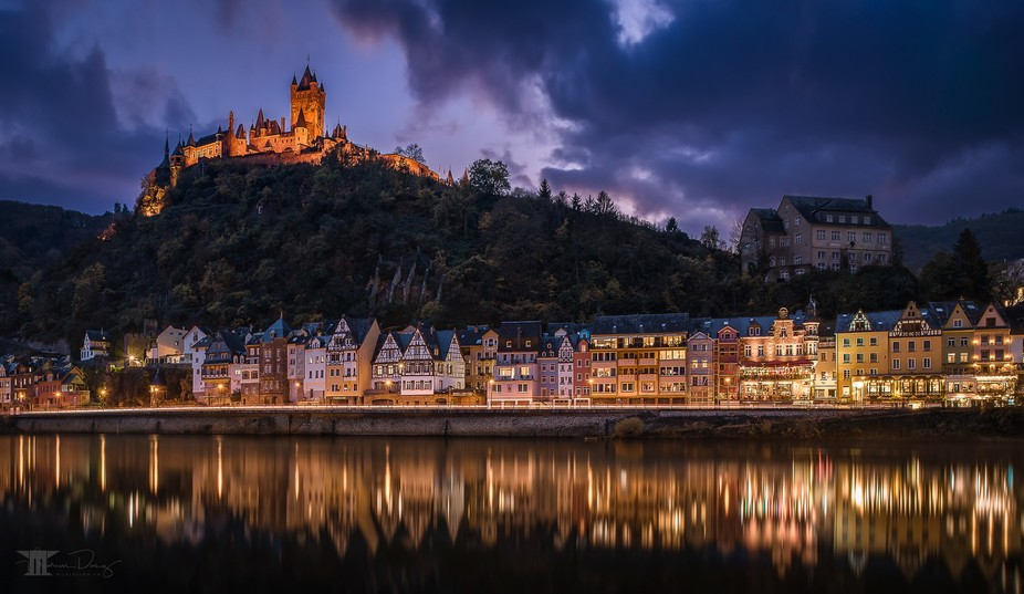 "High above Cochem towers the ""Reichsburg"" majestically over the city at the river Moselle."