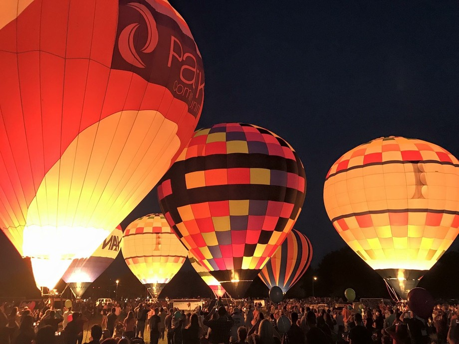 Hot air balloons glowing at night