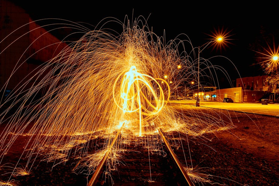 This is more like it, this must have been the first exposure showing all of the sparks created by lighting the steel wool on fire and spinning it around, creating light graffiti.