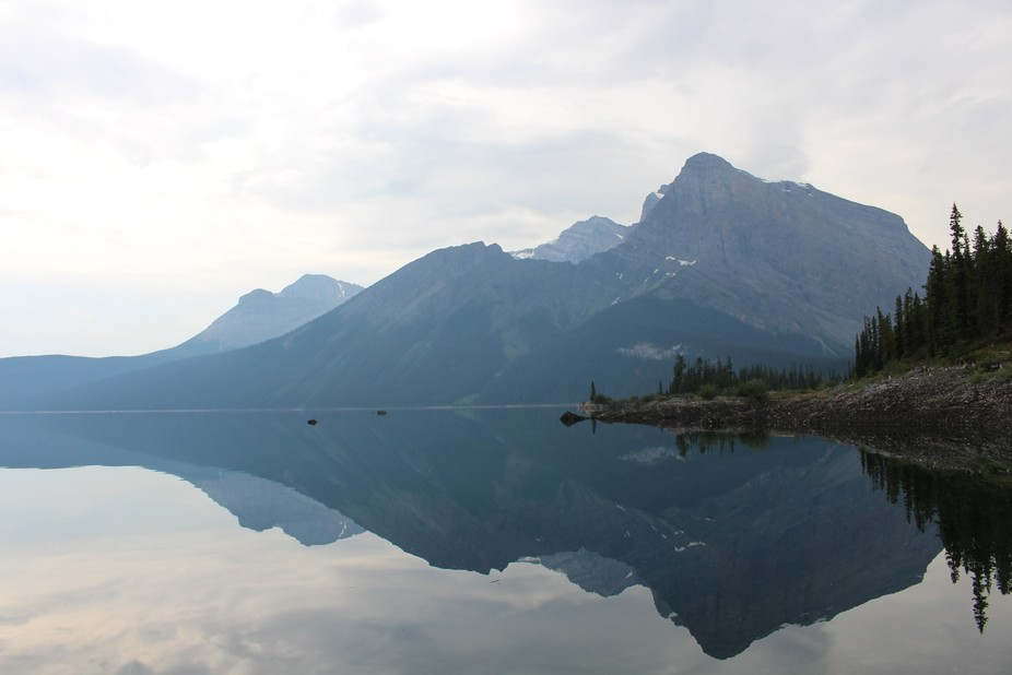 Hiking in Peter Lougheed Provincial Park; the water was calm and the day was overcast. Very few p...
