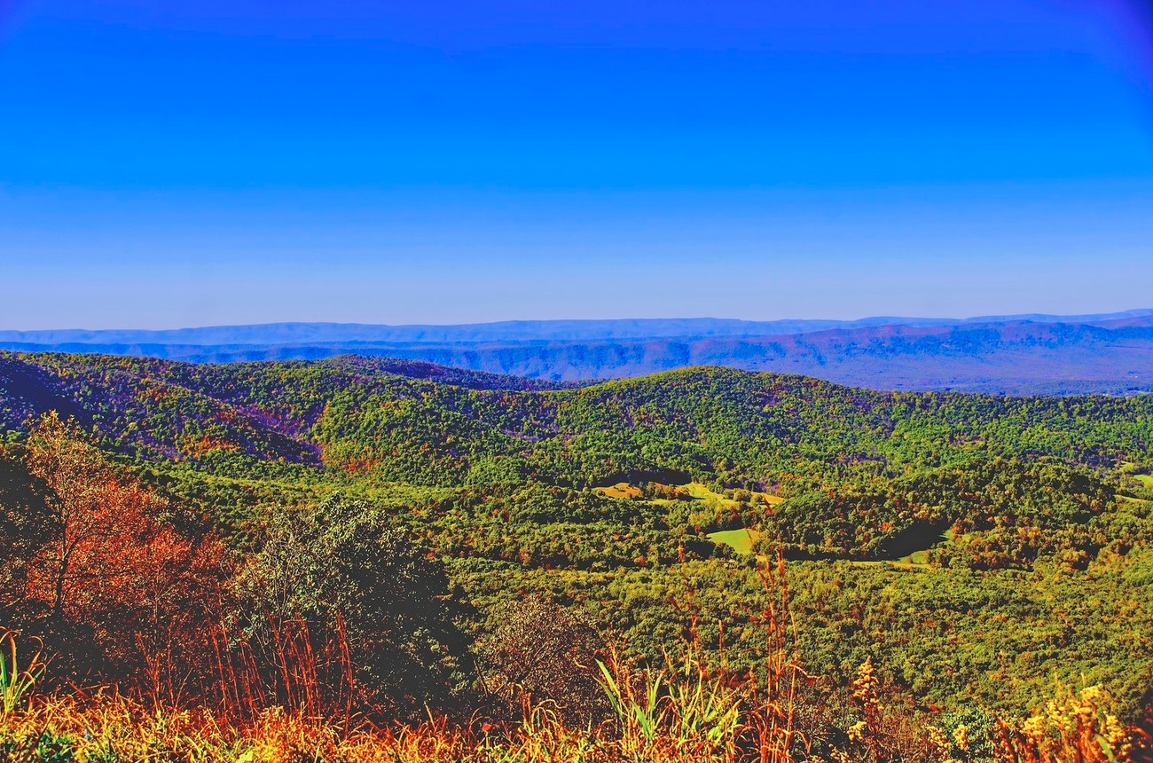 The rolling hills and blue haze of the Smokey Mountains.