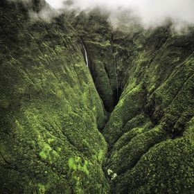 On a cloudy day I was fortunate enough to take a helicopter ride into a beautiful valley on Maui. The waterfalls were simply breathtaking