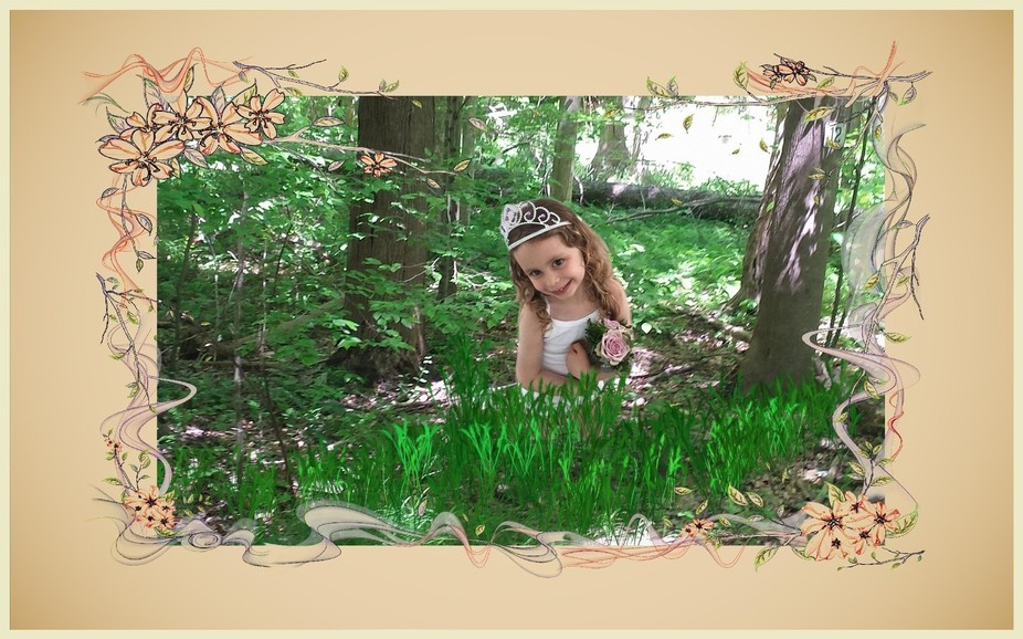 A little girl in the woods holding a bunch of flowers