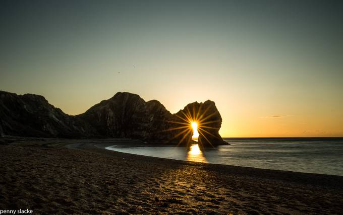 Durdle Door - Sunrise through the Arch  by PennySlacke - Landscapes And Sand Photo Contest