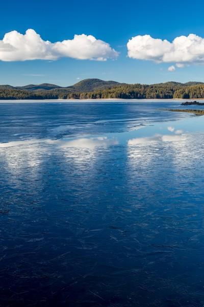 White clouds reflections into frozen lake water, Shiroka Polyana lake