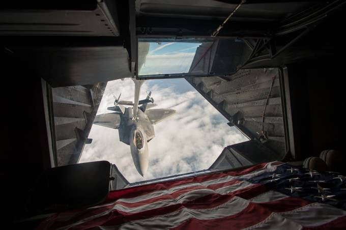 Flying in the back of a KC-10 extender refueling an F-22 Raptor over Syria.  by coltonelliott - Compositions 101 Photo Contest vol4