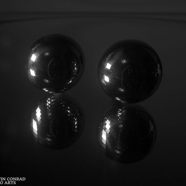 Silver spheres on mirrored surface