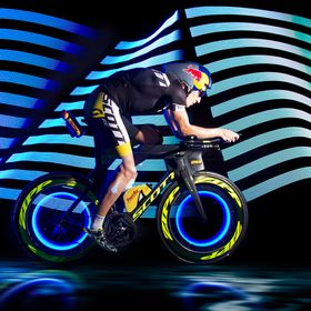 Editorial lightpainting shoot with ironman champion Sebastian Sebi Kienle. This photo was taken in a complete dark studio, only the rolls got era...