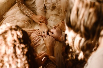 Hands Laid on a Bride