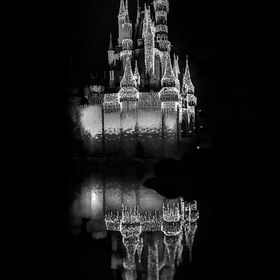 Cinderella's castle stands covered in ice and snow after Elsa worked her magic...