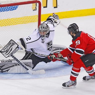 NHL: Stanley Cup Finals-Los Angeles Kings at New Jersey Devils  June 9, 2012; Newark, NJ, USA; Los Angeles Kings goalie Jonathan Quick (32) makes a save on a shot by New Jersey Devils center Travis Zajac (19) during the second period of game five of the 2012 Stanley Cup Finals at the Prudential Center.