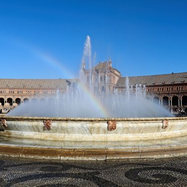 After a presenting at a Conference in Seville, the Conference Organizers took the participants on a tour of the city. I took this photo in front of a fountain at the Plaza de Espana. The rainbow in the fountain also caught my attention.
