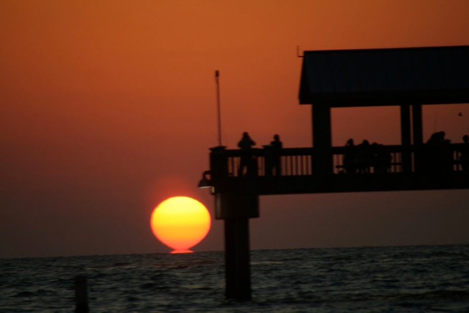 This photo was taken at Pier 60 in Clearwater FL. Just as the sun kissed the water I snapped this...