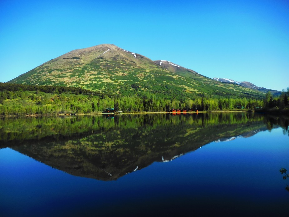 Calm waters on Summit Lake, located near the Turnagin Pass in Alaska