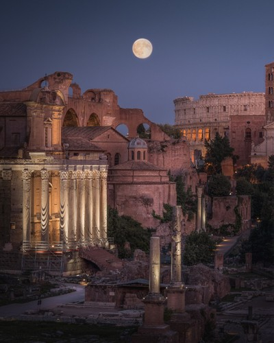 The Harvest Moon rising over the Roman Forum