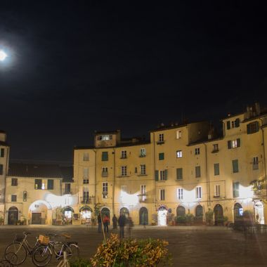 The Lucca Piazza dell'Anfiteatro  is one of Lucca's most beloved sites. Built in the  1st or 2nd century BC as a Roman Amphitheater. I love walking around it late at night during a full moon.
