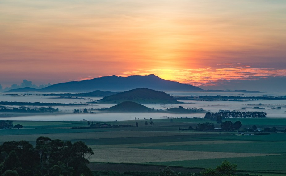 Early morning in Atherton at Halloran's Hill Lookout looking over farmland and a few of ...
